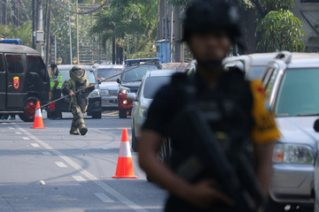 Police search the area at the Indonesian Christian Church following a blast in Surabaya, East Java,