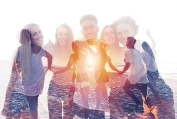 Group of happy friends having fun at ocean beach. double exposure