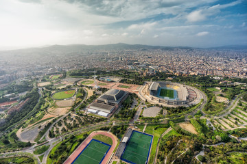 Barcelona aerial wide angle panorama, Anella Olimpica complex with city skyline , Spain