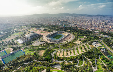 Barcelona aerial city panorama, sport complex on the hill with city skyline , Spain