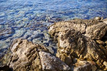 clean sea water and a stone beach