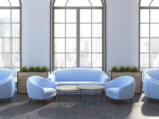 Hotel restaurant interior, blue armchairs, sofas