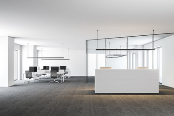 Open space office with a white reception desk