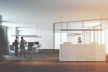 Open space office with white reception desk toned
