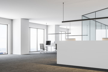 Open space office with a white reception desk side