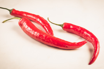 fresh red chili pepper/fresh red chili pepper on a white background. selective focus