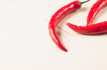 fresh red chili pepper/fresh red chili pepper on a white marble  background. Sective focus. Copy space