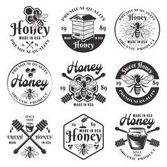 Honey and beekeeping set of black vector emblems