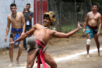 Players participate in the national championship for the Mesoamerican ballgame, an ancient indigenous game, near Teotihuacan, the pre-Hispanic city outside Mexico City, Mexico
