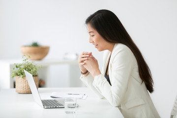 Happy young asian woman reading good online news on laptop, motivated chinese businesswoman, student or employee feels excited by new job opportunity, great deal or result looking at computer screen
