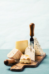 Variety of cheeses on serving board