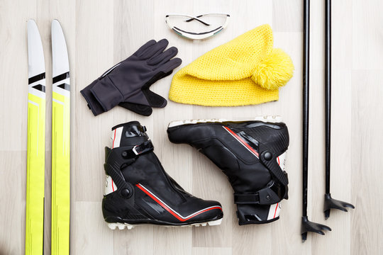 Image of skier accessories on wooden background.