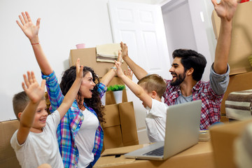 Happy young family moving into their new home.