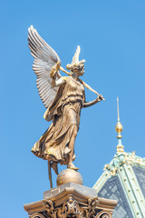 Statue of beautiful angel with wings in front of the Rudolfinum concert hall in Prague, Czech Republic