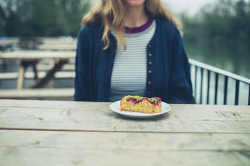 Woman eating cake outside