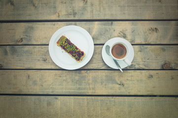 Coffee and cake on table outside