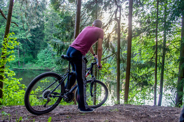 THE MAN IN THE FOREST ON THE BICYCLE
