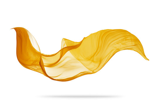 Piece of flying golden cloth on white background