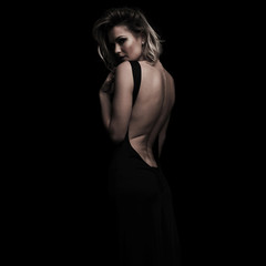 side view of seductive woman wearing an open back dress