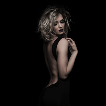 seductive elegant woman with messy blonde hair looking down