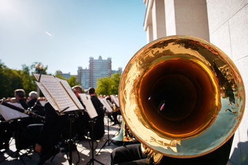Unidentified musicians play classical music on the playground at the Bolshoi Theater in Minsk, Belarus..Alto horn close up in Background during Outdoor concert. Entertainment to citizens and tourists.