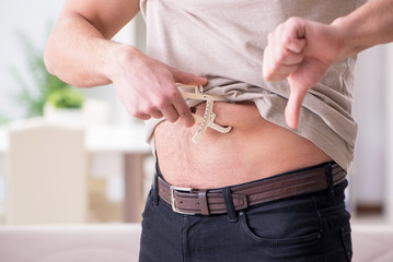 Man measuring body fat with calipers