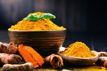 Fotobehang Kruiden Composition with bowl of turmeric powder on wooden table