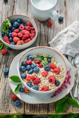 Closeup of granola with milk and fresh berry fruits