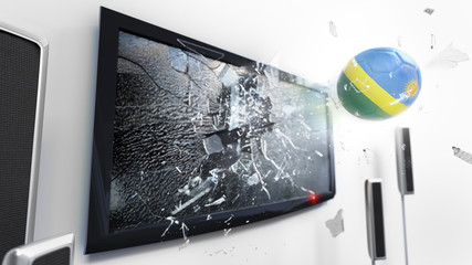 Soccer ball with the flag of Rwanda kicked through a shattering tv screen.(3D rendering series)