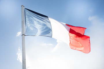 french flag in wind and cloud sky outdoor in Paris
