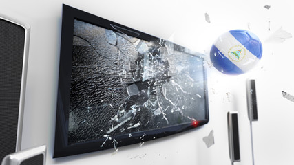 Soccer ball with the flag of Nicaragua kicked through a shattering tv screen.(3D rendering series)