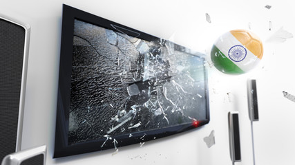 Soccer ball with the flag of India kicked through a shattering tv screen.(3D rendering series)