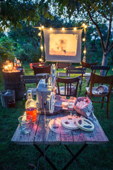 Small cinema with old analog films in summer garden