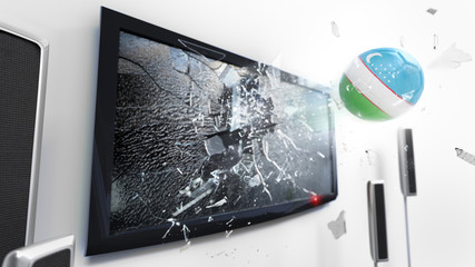 Soccer ball with the flag of Uzbekistan kicked through a shattering tv screen.(3D rendering series)