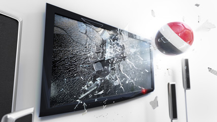Soccer ball with the flag of Yemen kicked through a shattering tv screen.(3D rendering series)