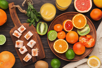 Variety of ripe citruses on wooden background