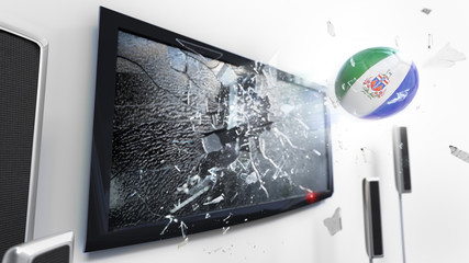 Soccer ball with the flag of Yukon kicked through a shattering tv screen.(3D rendering series)
