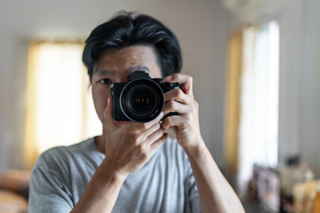 a man taking photography by digital mirrorless camera
