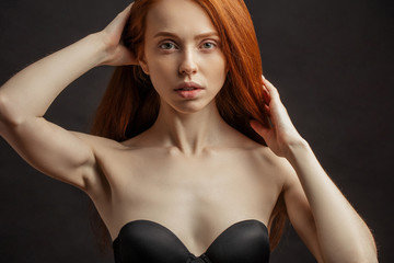 a7de2270eedcc Close up portrait of beautiful young woman with long healthy red hair  dressed in strapless bra