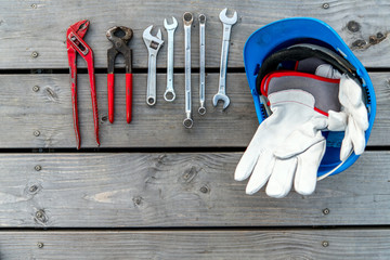 blue helmet, different tools and work gloves
