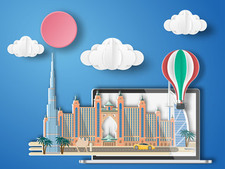 Paper art Dubail,UAE infographic . Dubai cityscape with labtop .