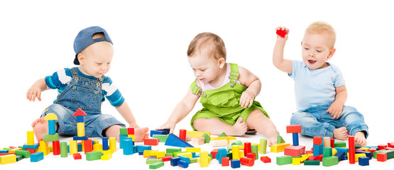 Children Play Blocks Toys, Kids Group Playing Colorful Building Bricks, Babies Isolated over White Background