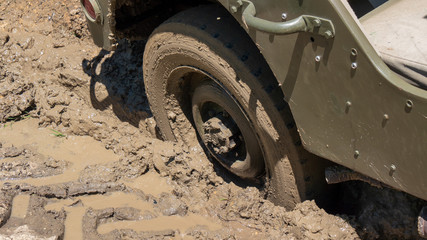 wheel of military vehicle in the mud