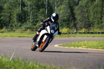 Rider on motorcycle turn in apex on the race track. .Bike, biker, moto, highway