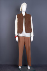 Female mannequin in stylish outfit. Dummy wearing female formal waistcoat and brown trousers. Female white knitted sweater and brown formal vest.