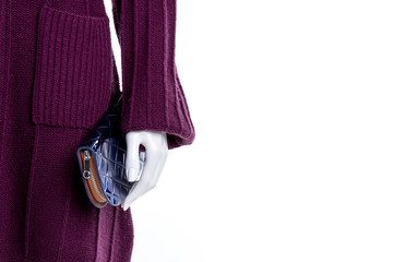 Female mannequin with wallet, copy space. Close up female mannequin with knitted cardigan and purse, cropped image.