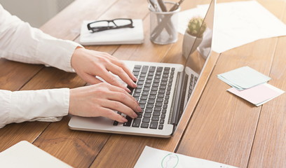 Woman working at office, hand on keyboard close up