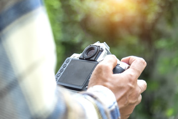 Photographer checking picture on digital camera