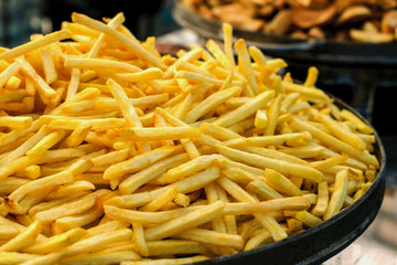 Production of french fries. Large pan of fresh fried sweet potato.