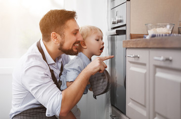 father with child son prepares meal, bakes cookies.